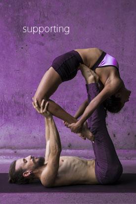 couple doing acro yoga
